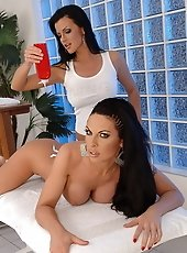 Two brunette lesbians are  having sex in a spa