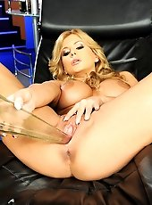 Blonde babe is stuffing a glass vase into her pussy
