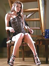 Sexy Suzie does a strip tease on chair