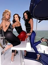 A very hot lesbian threesome action on a yacht