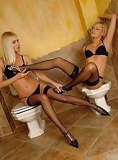 Erotic blondies in stockings peeing on each feet