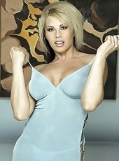 High class blonde in a blue dress bangs before dinner.
