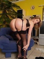 Foxy brunette in sheer stockings enjoys teasing her tight box
