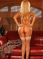 Sexy blonde Sandy is stuffing dildo into her pussy