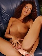 Sexy brunette Leanna Love is dildoing