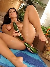 Nice titted Tiffany stuffing cucumber in her holes