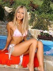 Busty blonde Bridgett is fingering by the pool