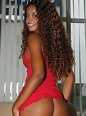 Sexy ebony Fernanda is posing and anal fingering