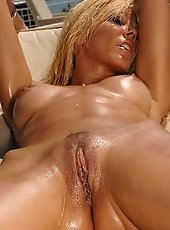 Very erotic busty Sandy posing and fisting herself